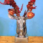 Silver ceramic tabletop reindeer.