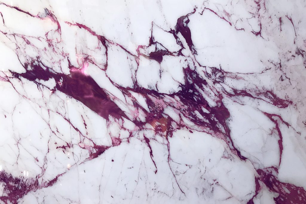 """Sicis """"Electric Marble"""" with fuschia veining. A thin-profile Vetrite glass material that looks like perfect, yet impossible marble."""